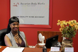 Receptionist sitting at desk at the Atlanta location of Bavarian Body Works