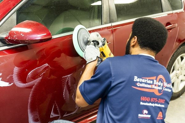 Worker doing auto body repair in Georgia