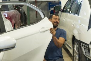 Auto glass repair work being done at Bavarian Body Works in Georgia